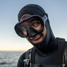 Chris Honeyman wearing dive gear and smiling
